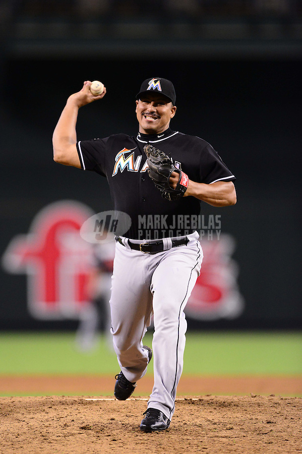 Aug. 22, 2012; Phoenix, AZ, USA: Miami Marlins pitcher Carlos Zambrano pitches in the eighth inning against the Arizona Diamondbacks at Chase Field. Mandatory Credit: Mark J. Rebilas-