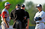 18 June 2010: Vermont Lake Monsters Manager Jeff Garber (right) exchanges lineup cards and discusses the ground rules with Spinners Manager Bruce Crabbe and the officials prior to a game against the Lowell Spinners at Centennial Field in Burlington, Vermont. The Lake Monsters defeated the Spinners 9-4 in the NY Penn League season home opener. Mandatory Credit: Ed Wolfstein Photo