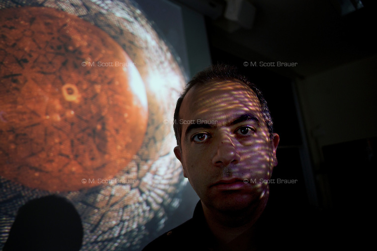 Dr. Joseph Formaggio is an Associate Professor in MIT's Department of Physics in Cambridge, Massachusetts, USA. Formaggio's research focuses on high energy physics and he is involved with major experimental research efforts:  the Sudbury Neutrino Observatory (SNO), KATRIN, and Project 8 / CosmoNeut.  The image projected is a view of the Sudbury Neutrino Observatory acrylic vessel and PMT array.