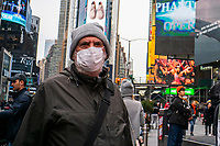 NEW YORK, NEW YORK - MARCH 03 : People wear face masks in Times Square New York on March 03, 2020. New York confirms second coronavirus case, as flights cancelations and Jewish schools close over virus fears.The first person to test positive for coronavirus in the state is a 39-year-old health-care worker who arrived from Iran with her husband, the second one is an attorney who lives in Westchester County, works in Manhattan, Gov. Andrew Cuomo said. (Photo by Eduardo MunozAlvarez / VIEWpress via Getty Images)