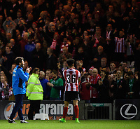 Lincoln City manager Danny Cowley, left, and Lincoln City's Josh Ginnelly applaud the fans at the end of the game<br /> <br /> Photographer Chris Vaughan/CameraSport<br /> <br /> Vanarama National League - Lincoln City v Chester - Tuesday 11th April 2017 - Sincil Bank - Lincoln<br /> <br /> World Copyright &copy; 2017 CameraSport. All rights reserved. 43 Linden Ave. Countesthorpe. Leicester. England. LE8 5PG - Tel: +44 (0) 116 277 4147 - admin@camerasport.com - www.camerasport.com