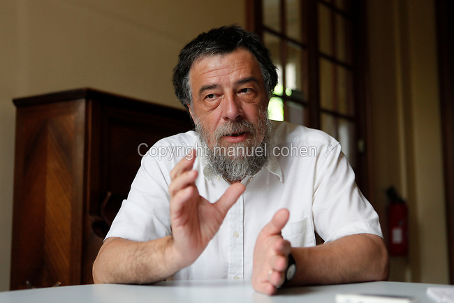 "Gilles Godefroy, a mathematician, Director of Research at CNRS (Centre National de la Recherche Scientifique), pictured at his residence on July 07, 2009 in Paris, France. He is also the author of ""L'aventure des nombres"" (""The Adventure of Numbers"", published by Odile Jacob, 1997. Picture by Manuel Cohen"