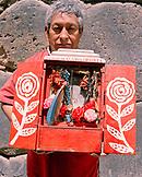PERU, Urubamba, South America, Latin America, mature man holding a sacred object