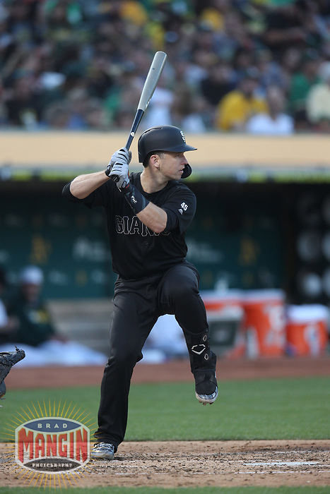 OAKLAND, CA - AUGUST 24:  Buster Posey #28 of the San Francisco Giants bats against the Oakland Athletics during the game at the Oakland Coliseum on Saturday, August 24, 2019 in Oakland, California. Both teams are wearing special uniforms for Players Weekend. (Photo by Brad Mangin)