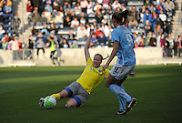 Philadelphia defender Sara Larsson (7) slides to kick the ball away from Chicago defender Whitney Engen (9).  The Philadelphia Independence defeated the Chicago Red Stars 1-0 at Toyota Park in Bridgeview, IL on May 15, 2010.