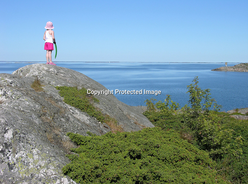 Child Enjoying View of Sea on Island of Kökar, Åland, Finland