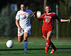 Sacred Heart No. 8 Kerri Bradley, left, and St. John the Baptist No. 21 Gianna Giroux race after a loose ball during a CHSAA varsity girls' soccer game at Sacred Heart Academy on Monday, October 5, 2015. Sacred Heart won by a score of 3-1.<br /> <br /> James Escher