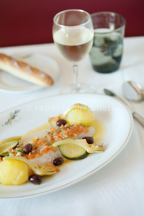A dish of John Dory à la niçoise prepared by Jacques Maximin and served at his restaurant 'Le Bistro de la Marine', Cagnes sur Mer, France, 07 April 2012. Chef Jacques Maximin changes his menu according to the catch of his main supplier, a small-boat fisherman in Nice.