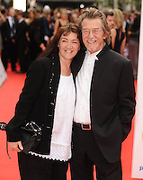 John Hurt and wife arriving for the BAFTA Television Awards 2010 at the London Palladium. 06/06/2010  Picture by: Steve Vas / Featureflash
