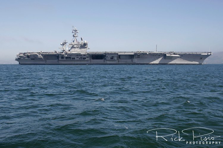 The USS Carl Vinson (CVN 70) enters San Francisco Bay. The Vinson is the third of the United States Navy's Nimitz class supercarriers. During 2011 CVN 70 was the last place that Osama Bin Laden's body was before being buried at see and on 11/11/11 it played host to the first NCAA basketball game to be played on an aircraft carrier.<br />