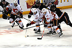Calgary Flames center Mikael Backlund (11) and Calgary Flames left wing Jiri Hudler (24) control the puck as St. Louis Blues center Patrik Berglund (21) and St. Louis Blues left wing David Perron (57) shadow them in the first period during a game between the Calgary Flames and the St. Louis Blues on Thursday April 25, 2013 at the Scottrade Center in downtown St. Louis.