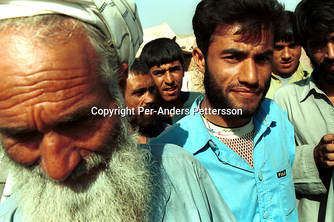 Unidentified newly arrived refugees from Afghanistan on October 6, 2001in New Shamshtoo, a camp run by UNHCR outside Peshawar in Pakistan. About 2 million Afghan refugee are in Pakistan who have arrived the last 20 years..(Photo: Per-Anders Pettersson/ Grazia Neri.