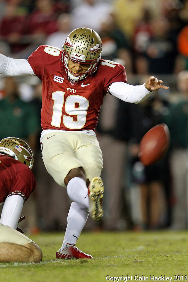 TALLAHASSEE, FL 11/2/13-FSU-MIAMI110213CH-Florida State's Roberto Aguayo kicks a field goal against Miami during second half action Saturday at Doak Campbell Stadium in Tallahassee. The Seminoles beat the Hurricanes 41-14.<br /> COLIN HACKLEY PHOTO
