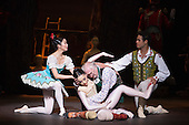 22/07/2014. London, England. L-R: Shiori Kase as Swanilda, Jung ah Choi as Coppélia Doll, Michael Coleman as Dr Coppélius and Yonah Acosta as Franz. Working stage rehearsal of Coppélia with the English National Ballet at the London Coliseum. With Shiori Kase as Swanilda and Yonah Acosta as Franz. Choreography by Ronald Hynd after Marius Petipa to music by Léo Delibes. Music performance by the Orchestra of the English National Ballet conducted by Gavin Sutherland. Photo credit: Bettina Strenske