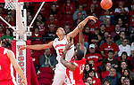 Wisconsin Badgers forward Ryan Evans (5) blocks the shot of Cornell Big Red Errick Peck (13) during an NCAA  college basketball game Sunday, November 18, 2012 in Madison, Wis. The Badgers won 73-40. (Photo by David Stluka)