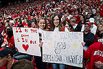 Wisconsin Badgers fans hold their homemade signs during a Big Ten Conference NCAA college basketball game against the Illinois Fighting Illini on Sunday, March 4, 2012 in Madison, Wisconsin. The Badgers won 70-56. (Photo by David Stluka)