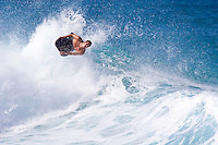 Man catching air on a bodyboard at rock piles surf break.