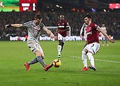 4th February 2019, London Stadium, London, England; EPL Premier League football, West Ham United versus Liverpool; James Milner of Liverpool crossing the ball over Aaron Cresswell of West Ham United