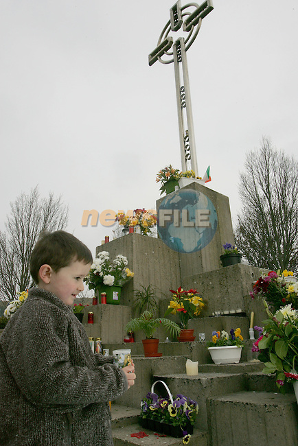 Drogheda Ireland 4 April 05 A young boy carries his candle to the papal monument site at Killaneer where Pop John Paul II  visited 26 years previous,in Drogheda, Ireland, a steady flow of people from North and South of the Irish boarder laid flowers and lit candles as people cam to terms with the death of the 84-year-old head of the Roman Catholic Church Pope John Paul II in Rome..Photo AFP/NEWSFILE/FRAN CAFFREY..(Photo credit should read AFP Photo FRAN CAFFREY/NEWSFILE)...This Picture has been sent you under the condtions enclosed by:.Newsfile Ltd..the Studio,.Millmount Abbey,.Drogheda,.Co Meath..Ireland..Tel: +353(0)41-9871240.Fax: +353(0)41-9871260.GSM: +353(0)86-2500958.email: pictures@newsfile.ie.www.newsfile.ie.FTP: 193.120.102.198..This picture is from Fran Caffrey@newsfile.ie