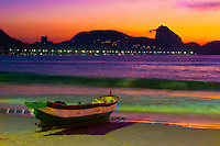 Multicolored sunrise at Copacabana beach, Sugar Loaf and fishing boat, Rio de Janeiro, Brazil.