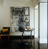 A large Sigmar Polke painting and a vintage Jacques Quinet armchair in the entrance hall