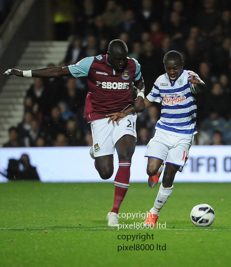 Shaun Wright-Phillips of Queens Park Rangers holds off Mohamed Diame of West Ham United during the Barclays Premier League match between West Ham United and Queens Park Rangers at Loftus Road on Monday ,01 October 2012 in London, England. Picture Zed Jameson/pixel 8000 ltd