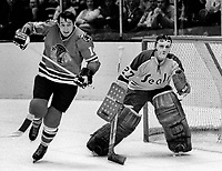 Chicago Blackhawks Bryan Campbell along side of California Golden Seals goalie Gilles Meloche,(1971 photo/Ron Riesterer)