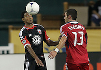WASHINGTON, DC. - AUGUST 22, 2012:  Lionard Pajoy (26) of DC United heads the ball past  Gonzalo Segares (13) of the Chicago Fire during an MLS match at RFK Stadium, in Washington DC,  on August 22. United won 4-2.