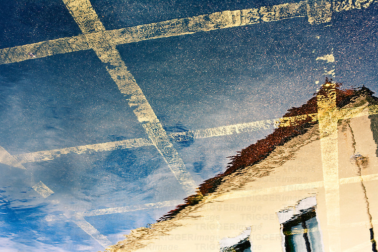 Car Park Reflection showing no parking yellow lines and a building