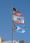 Flags flying over entrance to the Oceanside Pier in Oceanside, CA on Wednesday, April 27, 2016. Photo by Jim Peppler. Copyright Jim Peppler  2016.
