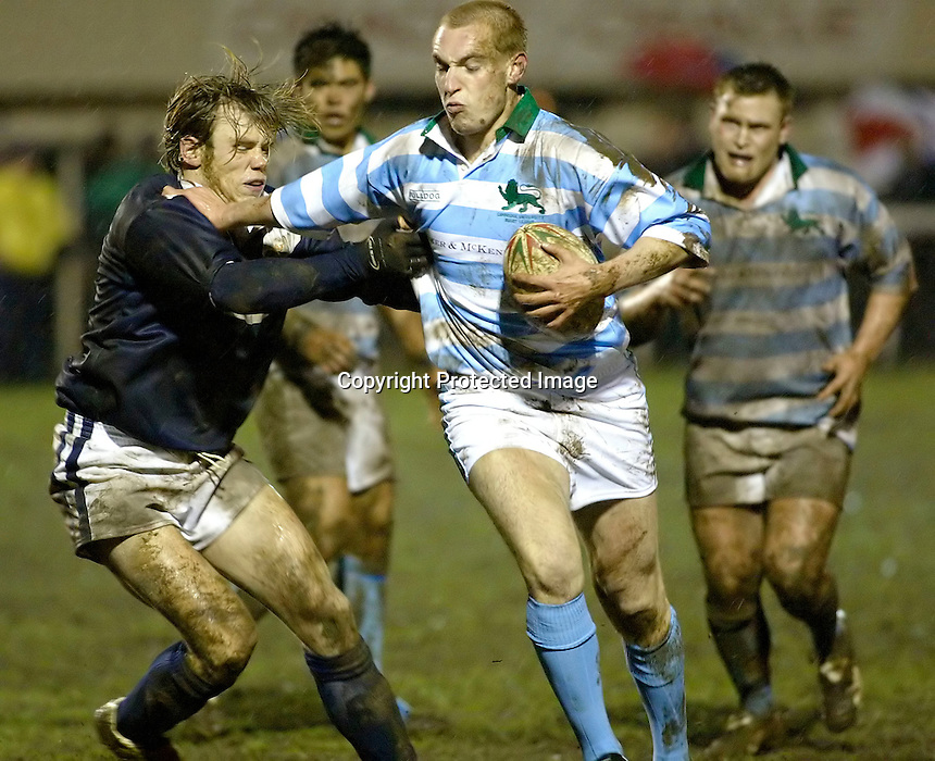 Cambridge University / Oxford University..Pcubed 23rd Rugby League Varsity match..The Athletic Ground, Richmond, March 5, 2003..Pic : Max Flego... Cambridges' Chris Sawyer holds off Oxfords' Llywelyn ap Gwilym
