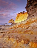 Sandstone rock formations at Cape Kiwanda at sunrise. Pacific City, Oregon.
