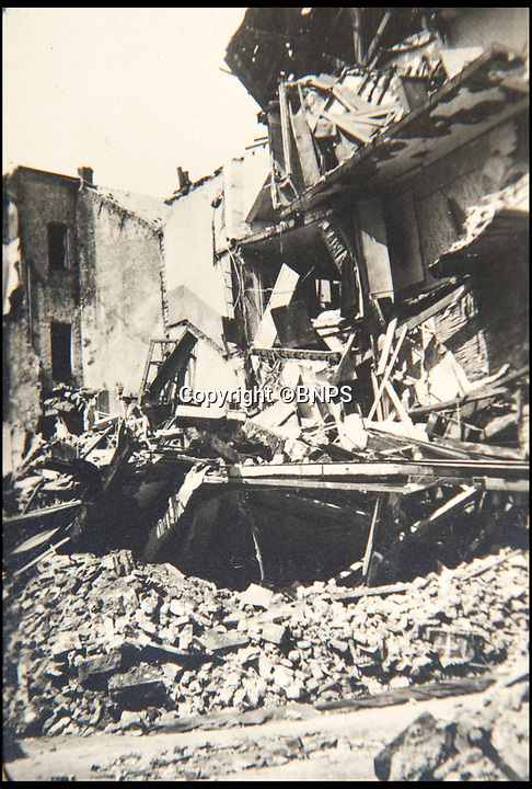 BNPS.co.uk (01202 558833)<br /> Pic: BNPS<br /> <br /> Damage to a house in Ostend.<br /> <br /> Haunting photos which capture the trail of devastation left in the wake of the Dunkirk evacuation have been unearthed after 77 years.<br /> <br /> The poignant pictures were taken soon after 330,000 Allied troops had been rescued from the beaches by an armada of little ships having been defeated by the Germans.<br /> <br /> The epic operation is about to be the subject of the new Hollywood blockbuster movie 'Dunkirk' will stars Tom Hardy and Harry Styles and is die for release on July 21.<br /> <br /> The black and white snaps show German soldiers surveying the wreckage which included destroyed ships and large military trucks lying in the surf.<br /> <br /> They are being sold by Duke's Auctioneers.