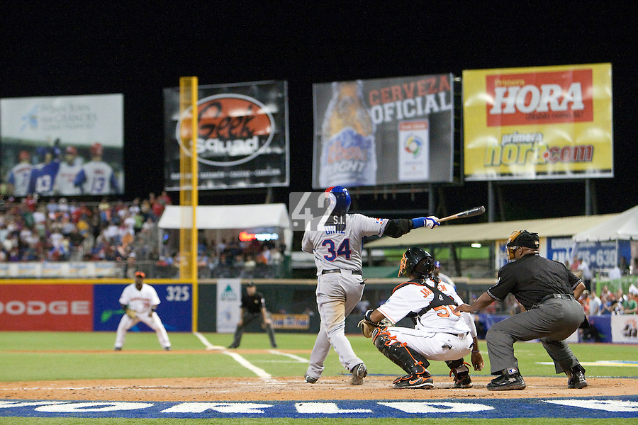 10 March 2009: #34 David Ortiz of the Dominican Republic hits a fly ball during the 2009 World Baseball Classic Pool D game 5 at Hiram Bithorn Stadium in San Juan, Puerto Rico. The Netherlands pulled off second upset to advance to the secound round. The Netherlands come from behind in the bottom of the 11th inning and beat the Dominican Republic, 2-1.