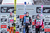 1st January 2020, Olympiaschanze, Garmisch Partenkirchen, Germany, FIS World cup Ski Jumping, 4-Hills competition; 2nd placed Karl Geiger of Germany Winner Marius Lindvik of Norway 3rd placed David Kubacki of Poland during the winner ceremony for the Four Hills Tournament