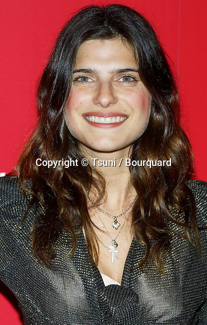 Lake Bell arriving at the Of Corsets for a Good Cause Benefit at the Rosevelt Hotel in Los Angeles. October 20, 2004.