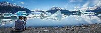 Photographer man takes photo from tripod and shore of ice berg and Colony Glacier at Inner Lake George. Summer. Southcentral, Alaska.   People/person.  Panorama/ panoramic<br /> <br /> (C) Jeff Schultz/SchultzPhoto.com