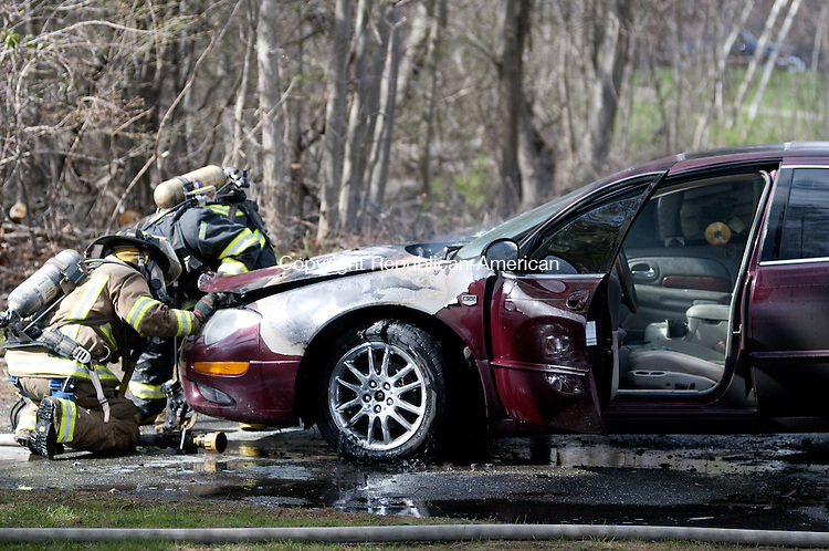 TORRINGTON, CT -03 MAY 2014 -- A car went up in flames in Torrington on Torringford West Street Friday afternoon. The Torrington Fire Department quickly extinguished the blaze. The cause was not immediately known. The car was being driven when it caught fire, fire officials said. Alec Johnson/ Republican-American