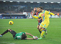 Gonzalo Higuain  shoot to scores in action during the Italian Serie A soccer match between SSC Napoli and Genoa CFC   at San Paolo stadium in Naples, Feburary 24 , 2014