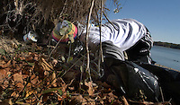 High school students clear debris and garbage from the shoreline of Hoover Reservoir in Columbus, Ohio, as part of their service club community involvement requirement.<br />