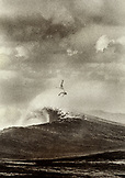 FIJI, surfer bailing out of a big wave at Frigates Pass (B&W)