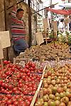 Italian vegetable vendor in Sicilian market.
