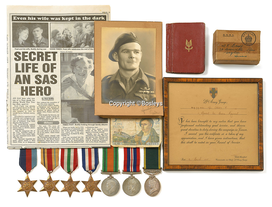 BNPS.co.uk (01202 558833)<br /> Pic: Bosleys/BNPS<br /> <br /> The unique archive details the life of the unassuming WW2 hero.<br /> <br /> Sold for £25,000 - An extraordinary wartime archive that lift's the veil on the earliest days of the SAS during WW2.<br /> <br /> The late Fred Casey was among the original dozen members of the 1st Special Air Service that was formed in North Africa to wreak havoc behind enemy lines.<br /> <br /> The commando's military possessions included a remarkable album containing previously unseen images of the founding members of the elite force.<br /> <br /> Legendary Captain David Stirling, who formed the 'Who Dares Wins' regiment, and hand-picked the men under his command, is pictured along with his controversial deputy Paddy Mayne , who took over the top secret regiment after Stirling's capture.<br /> <br /> The album sold at Bosley's Auctioneers of Marlow, Bucks, last week for over five times its pre-sale estimate..