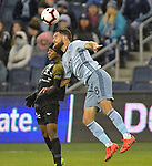 Romeesh Ivey of Independiente (left) and Graham Zusi of Sporting KC vie for a header. Sporting KC defeated Club Atletico Independiente 3-0 in a CONCACAF Champions League quarterfinal game at Children's Mercy Park on March 14, 2019.