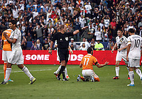CARSON, CA - DECEMBER 01, 2012:  Referee Silviu Petrescu points to a penalty kick for of the Los Angeles Galaxy against the Houston Dynamo during the 2012 MLS Cup at the Home Depot Center, in Carson, California on December 01, 2012. The Galaxy won 3-1.