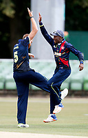 Ivan Thomas (L) is congratulated after taking a Netherlands wicket by Daniel Bell-Drummond during the T20 friendly between Kent and the Netherlands at the St Lawrence Ground, Canterbury, on July 3, 2018
