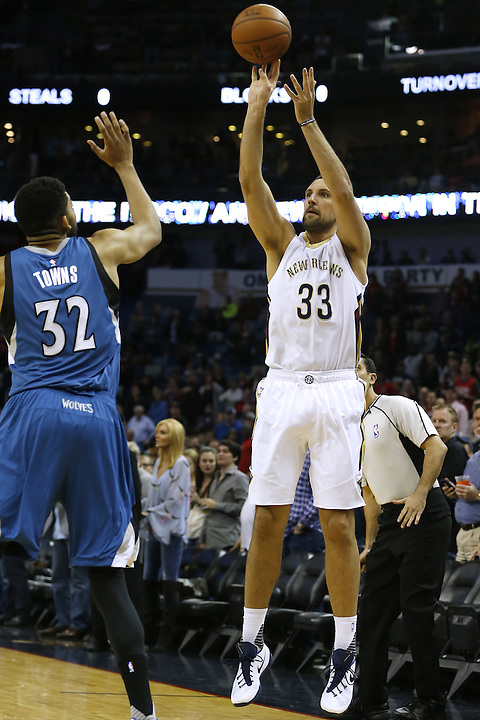 New Orleans Pelicans forward Ryan Anderson (33) shoots over Minnesota Timberwolves center Karl-Anthony Towns (32) during the first half of an NBA basketball game Saturday, Feb. 27, 2016, in New Orleans. (AP Photo/Jonathan Bachman)