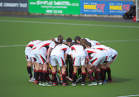 Hamilton BHS huddle before tip-off in the Rankin Cup boys hockey final match between  Westlake Boys' High School and Hamilton Boys' High School at National Hockey Stadium, Wellington, New Zealand on Friday, 6 September 2013. Photo: Dave Lintott / lintottphoto.co.nz