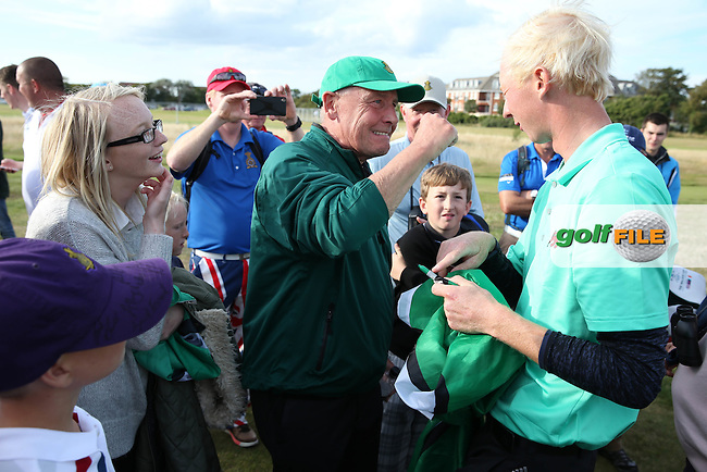 Autographing the Devon flag is Jimmy Mullen (ENG) after winning his match 3&amp;2 during Sunday afternoon Singles matches of The Walker Cup 2015 played at Royal Lytham and St Anne's, Lytham St Anne's, Lancashire, England. 13/09/2015. Picture: Golffile | David Lloyd<br /> <br /> All photos usage must carry mandatory copyright credit (&copy; Golffile | David Lloyd)