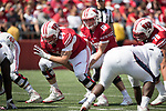 Wisconsin Badgers quarterback Jack Can (10) takes the snap from center Brett Connors (64) during an NCAA College Football game against the Florida Atlantic Owls Saturday, September 9, 2017, in Madison, Wis. The Badgers won 31-14. (Photo by David Stluka)